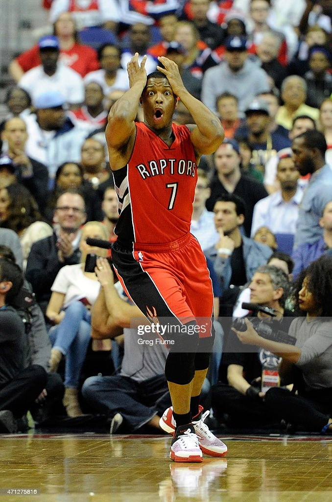 Kyle Lowry of the Toronto Raptors reacts after being called for a foul in the first quarter against the Washington Wizards during Game Four of the...