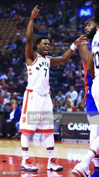 Kyle Lowry of the Toronto Raptors reacts during the first half of an NBA preseason game against the Detroit Pistons at Air Canada Centre on October...