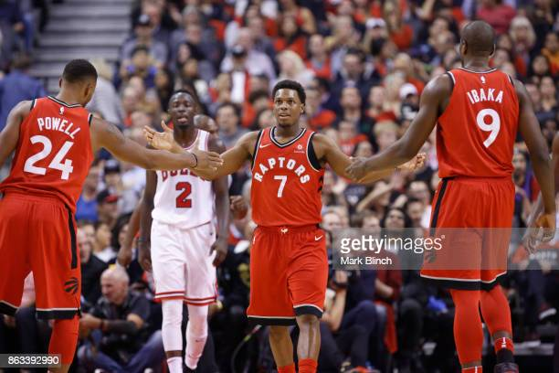 Kyle Lowry of the Toronto Raptors shake hands with teammates during the game against the Chicago Bulls on October 19 2017 at the Air Canada Centre in...