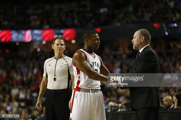Kyle Lowry of the Toronto Raptors shakes the hand of Michael Malone of the Denver Nuggets on October 3 2016 at the Scotiabank Saddledome in Calagary...