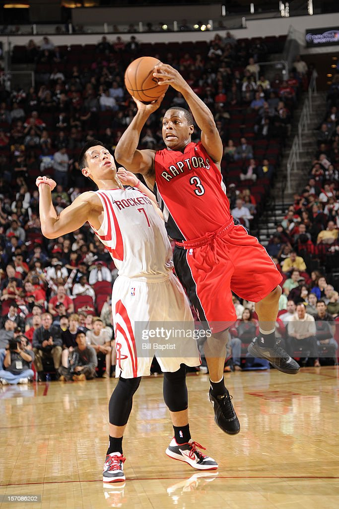 <a gi-track='captionPersonalityLinkClicked' href=/galleries/search?phrase=Kyle+Lowry&family=editorial&specificpeople=714625 ng-click='$event.stopPropagation()'>Kyle Lowry</a> #3 of the Toronto Raptors shoots against <a gi-track='captionPersonalityLinkClicked' href=/galleries/search?phrase=Jeremy+Lin&family=editorial&specificpeople=6669516 ng-click='$event.stopPropagation()'>Jeremy Lin</a> #7 of the Houston Rockets on November 27, 2012 at the Toyota Center in Houston, Texas.