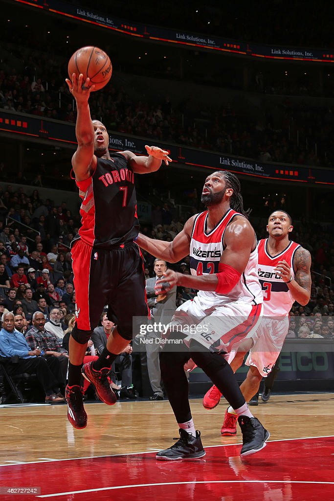 Kyle Lowry #7 of the Toronto Raptors shoots against Nene #42 of the Washington Wizards on January 31, 2015 at Verizon Center in Washington, DC.