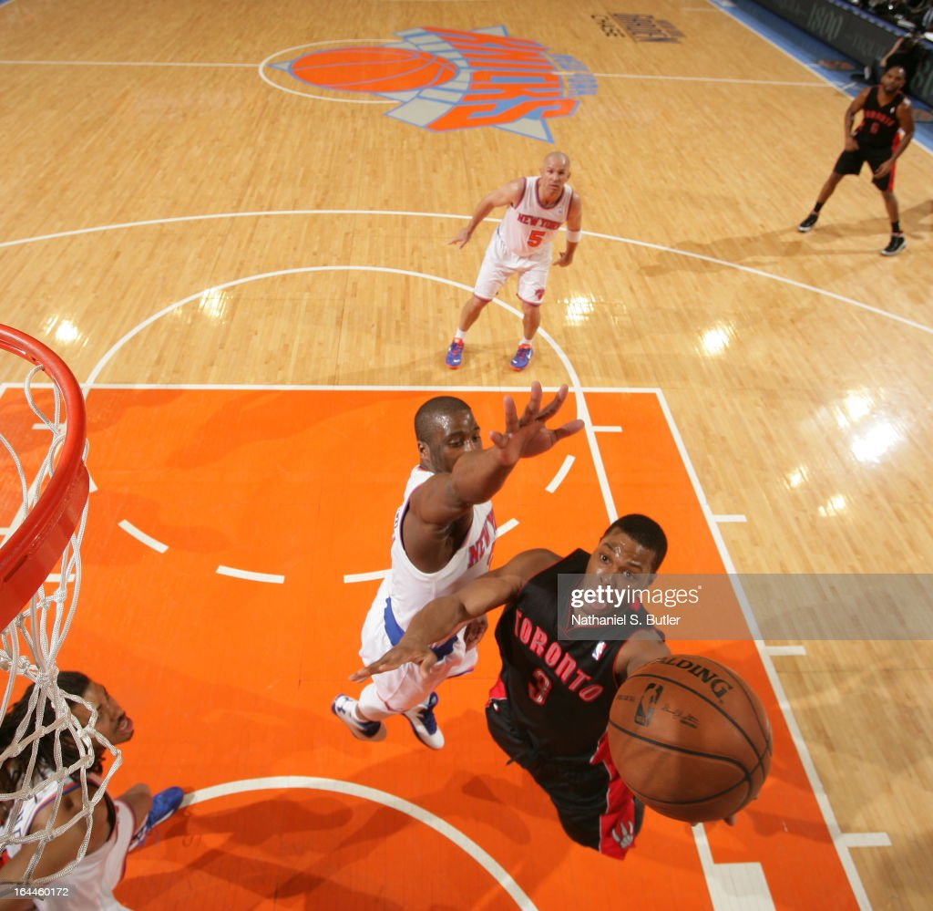 Kyle Lowry #3 of the Toronto Raptors shoots over Raymond Felton #2 of the New York Knicks on March 23, 2013 at Madison Square Garden in New York City.