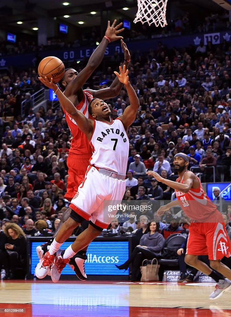 Kyle Lowry #7 of the Toronto Raptors shoots the ball as Montrezl Harrell #5 of the Houston Rockets defends during the second half of an NBA game at Air Canada Centre on January 8, 2017 in Toronto, Canada.