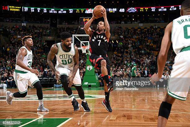 Kyle Lowry of the Toronto Raptors shoots the ball during the game against the Boston Celtics on December 9 2016 at TD Garden in Boston Massachusetts...