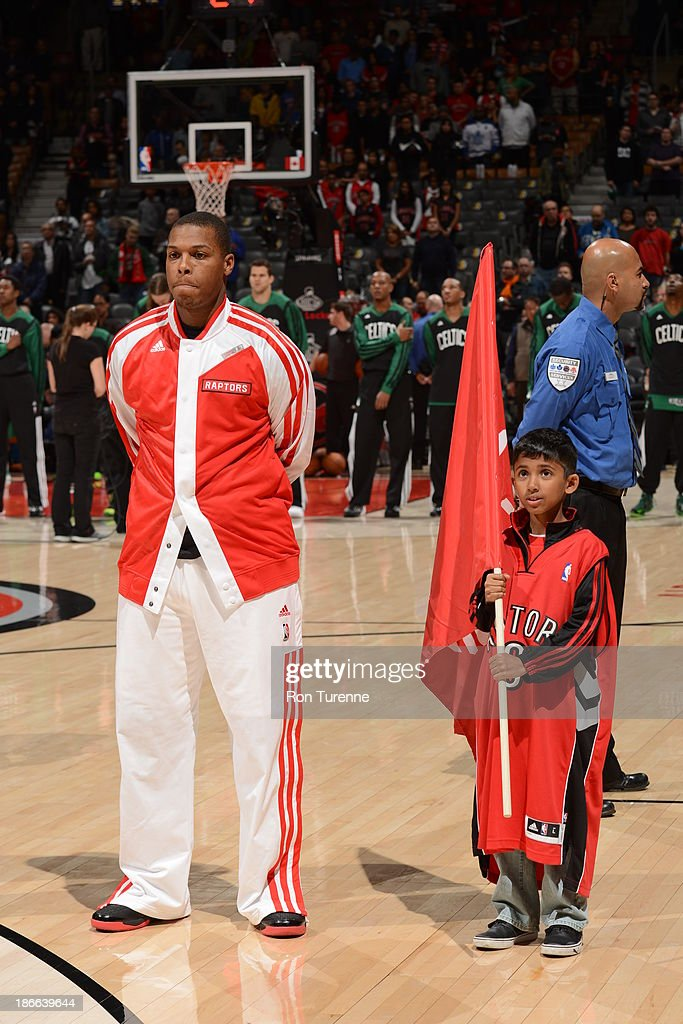 <a gi-track='captionPersonalityLinkClicked' href=/galleries/search?phrase=Kyle+Lowry&family=editorial&specificpeople=714625 ng-click='$event.stopPropagation()'>Kyle Lowry</a> #7 of the Toronto Raptors stands on the court against the Boston Celtics on October 23, 2013 at the Air Canada Centre in Toronto, Ontario, Canada.