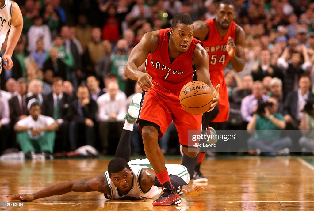 Kyle Lowry of the Toronto Raptors steals the ball from Marcus Smart of the Boston Celtics in the second half at TD Garden on November 5 2014 in...