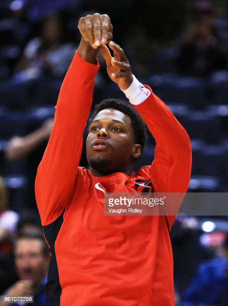 Kyle Lowry of the Toronto Raptors warms up prior to the first half of an NBA preseason game against the Detroit Pistons at Air Canada Centre on...
