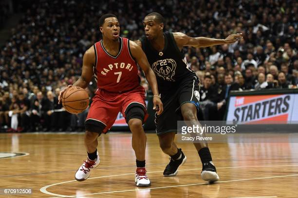 Kyle Lowry of the Toronto Raptors works against Khris Middleton of the Milwaukee Bucks during the second half of Game Three of the Eastern Conference...