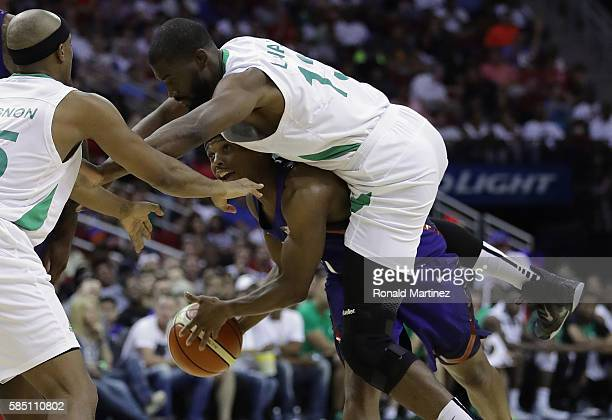 Kyle Lowry of the United States is fouled by Shane Lawal of Nigeria in a preOlympic exhibition game during USA Basketball Showcase at Toyota Center...