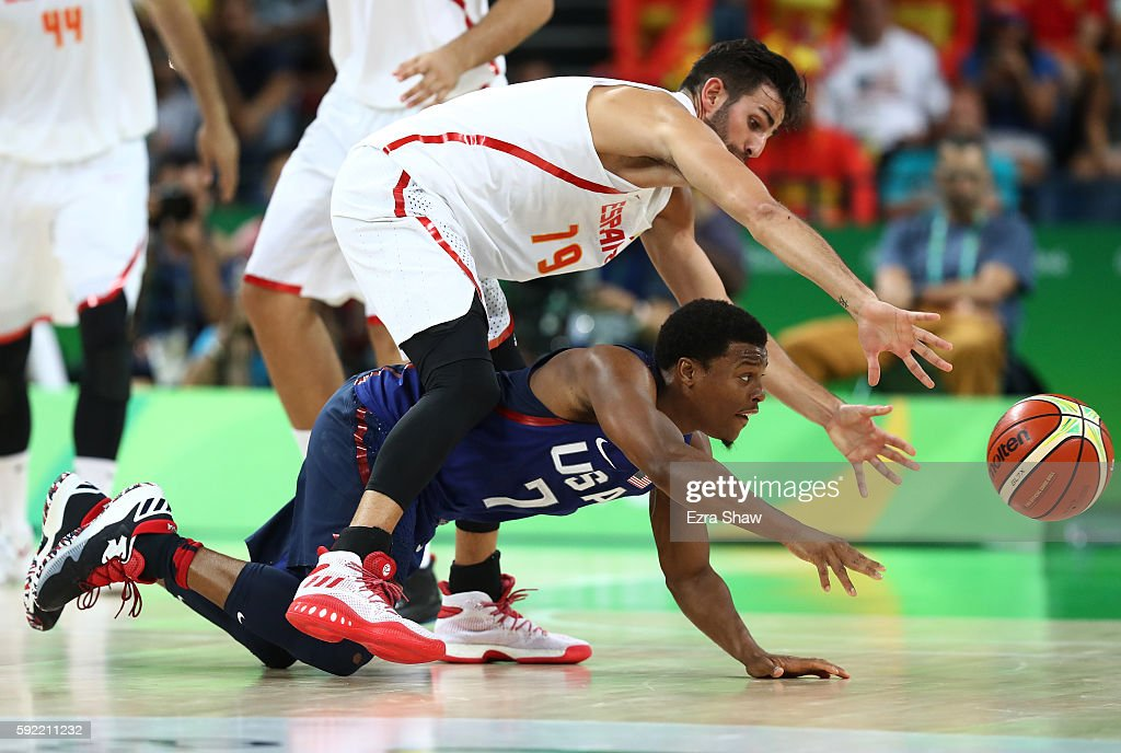 Kyle Lowry #7 of United States battles for the ball against Ricky Rubio #79 of Spain during the Men's Semifinal match on Day 14 of the Rio 2016 Olympic Games at Carioca Arena 1 on August 19, 2016 in Rio de Janeiro, Brazil.