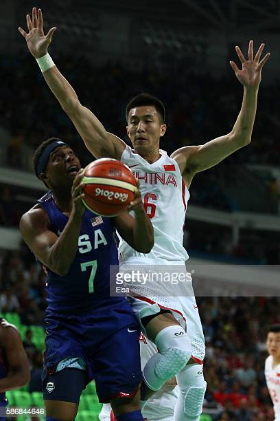Kyle Lowry of United States goes to the basket against Ailun Guo of China in the Men's Preliminary Round Group A match on Day 1 of the Rio 2016...