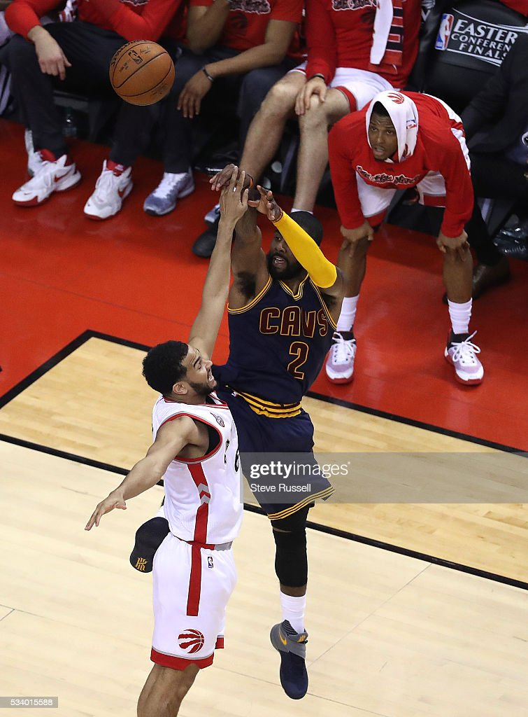 Kyle Lowry watches from the sidelines as Kyrie Irving shoots over Cory Joseph as the Toronto Raptors beat the Cleveland Cavaliers in game 4 of the NBA Conference Finals in Toronto. May 23, 2016.