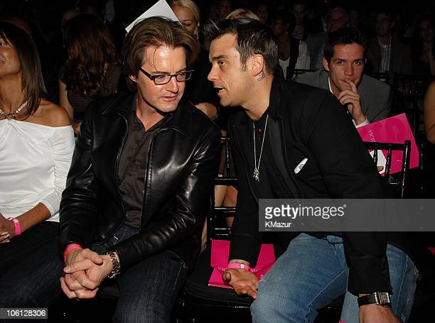 Kyle MacLachlan and Robbie Williams during 11th Victoria's Secret Fashion Show Audience at Kodak Theater in Los Angeles California United States