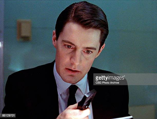 Kyle MacLachlan as Special Agent Dale Cooper hard on the heels of a murderer from the pilot episode of the hit television series 'Twin Peaks' 1990