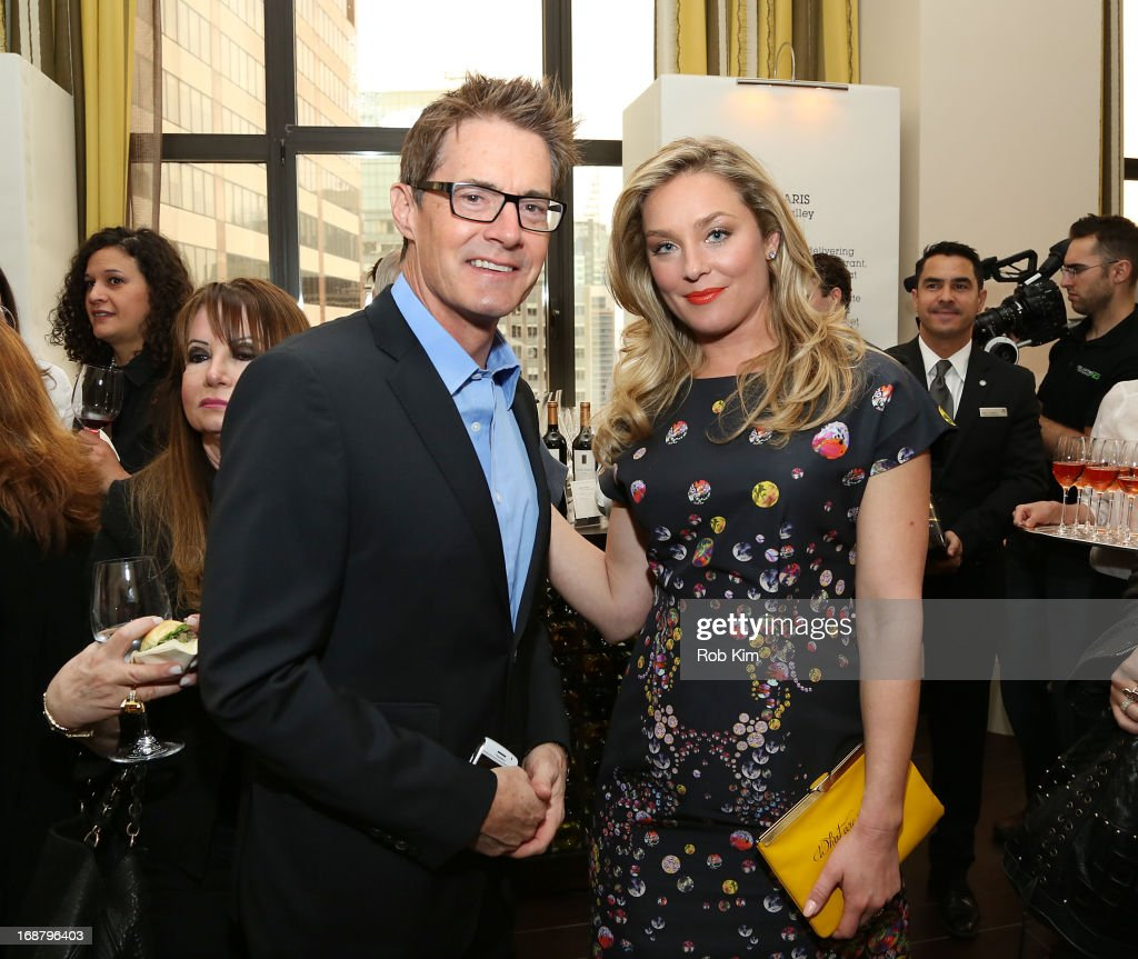 Kyle MacLaughlin and Elisabeth Rohm attend 'Toast Around the World' Celebration of Sheraton Social Hour! at New York Sheraton Hotel & Tower on May 15, 2013 in New York City.