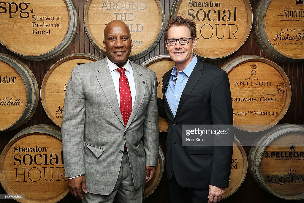Kyle MacLaughlin (R) and Hoyt Harper, Global Brand Leader at Sheraton Hotels attend 'Toast Around the World' Celebration of Sheraton Social Hour! at New York Sheraton Hotel & Tower on May 15, 2013 in New York City.