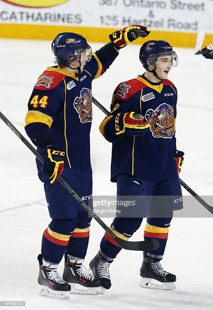 Kyle Maksimovich #9 of the Erie Otters celebrates a goal with Travis Dermott #44 during an OHL game against the Niagara IceDogs at the Meridian Centre on November 19, 2015 in St Catharines, Ontario, Canada.