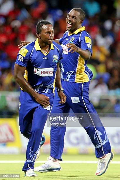 Kyle Mayers of Barbado Tridents celebrates with his teammate Raymon Riefer during the Limacol Caribbean Premier League 2014 final match between...