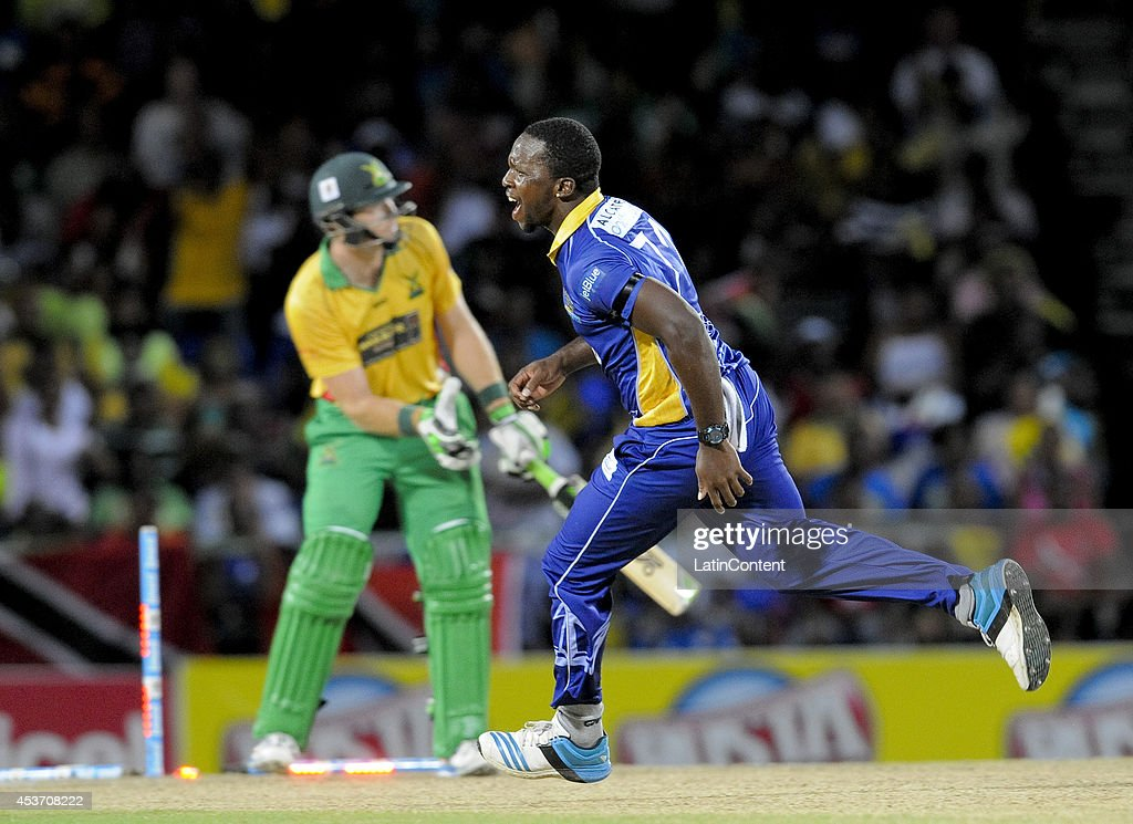 Kyle Mayers (R) of Barbados Tridents celebrates after bowling <a gi-track='captionPersonalityLinkClicked' href=/galleries/search?phrase=Martin+Guptill&family=editorial&specificpeople=797559 ng-click='$event.stopPropagation()'>Martin Guptill</a> of Guyana Amazon Warriors (B) during the the Limacol Caribbean Premier League 2014 final match between Guyana Amazon Warriors and Barbados Tridents at Warner Park on August 16, 2014 in Basseterre, St. Kitts and Nevis.