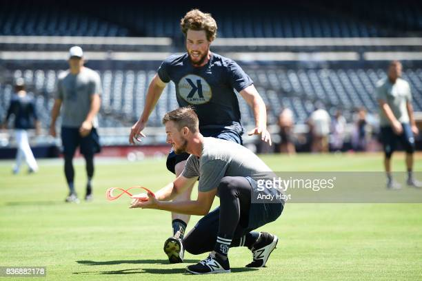 Kyle MCGrath and Carter Capps of the San Diego Padres play a frisbee game prior to the game against the Washington Nationals at Petco Park on August...