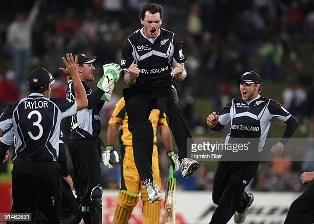 Kyle Mills of New Zealand celebrates the wicket of Ricky Ponting of Australia during the ICC Champions Trophy Final between Australia and New Zealand...