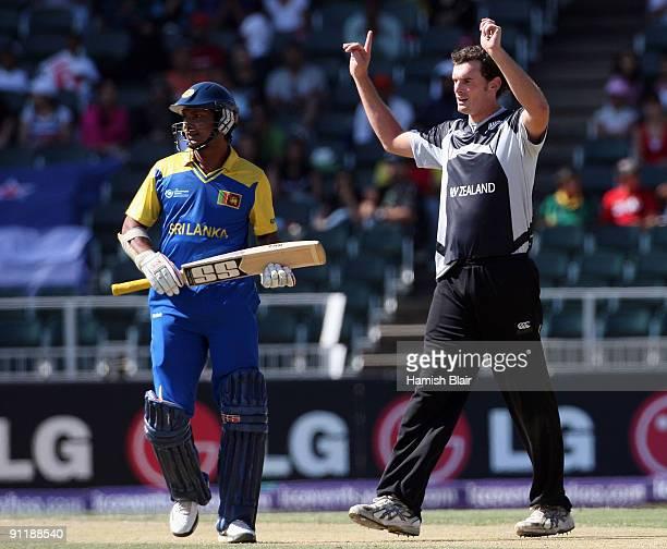 Kyle Mills of New Zealand celebrates the wicket of Tillakaratne Dilshan of Sri Lanka with Kumar Sangakkara of Sri Lanka looking on during the ICC...