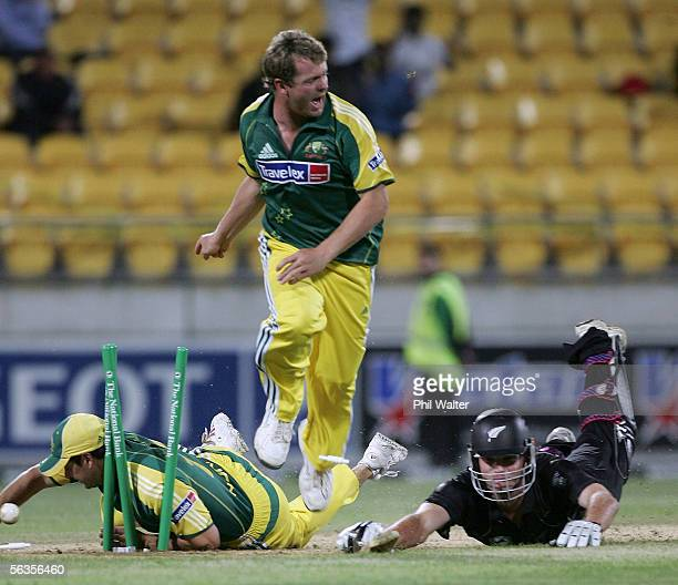 Kyle Mills of New Zealand is runout by Mick Lewis of Australia as Brad Hodge takes a fall to award Australia a two run win in the second...