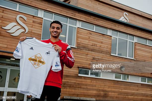 Kyle Naughton holds a Swansea City Jersey after completing a deal to sign from Swansea City FC from Tottenham Hotspur FC on January 22 2015 in...