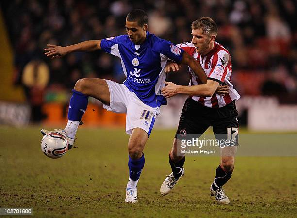 Kyle Naughton of Leicester battles with Richard Cresswell of Sheffield United during the npower Championship match between Sheffield United and...