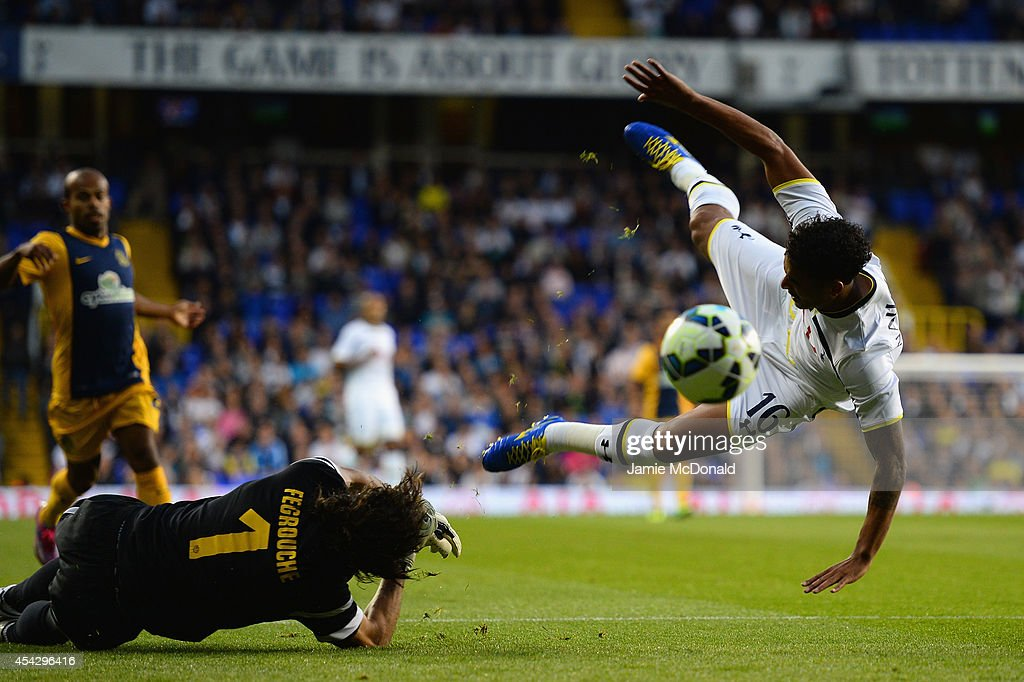 Kyle Naughton of Spurs is brought down in the area by Karim Fegrouche of AEL Limassol to win a penalty during the UEFA Europa League Qualifying Play-Offs Round Second Leg match between Tottenham Hotspur and AEL Limassol FC on August 28, 2014 in London, United Kingdom.