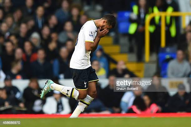 Kyle Naughton of Spurs reacts as he leaves the field after being shown the red card during the Barclays Premier League match between Tottenham...