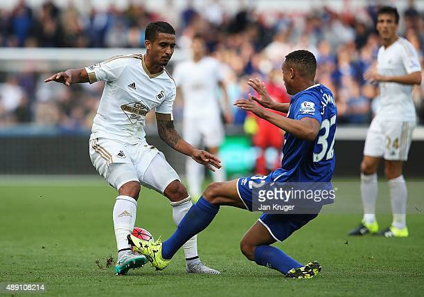 Kyle Naughton of Swansea City and Brendan Galloway of Everton compete for the ball during the Barclays Premier League match between Swansea City and...