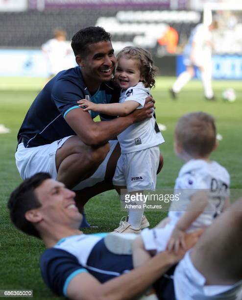 Kyle Naughton of Swansea City and Jack Cork play with their young children after the Premier League match between Swansea City and West Bromwich...