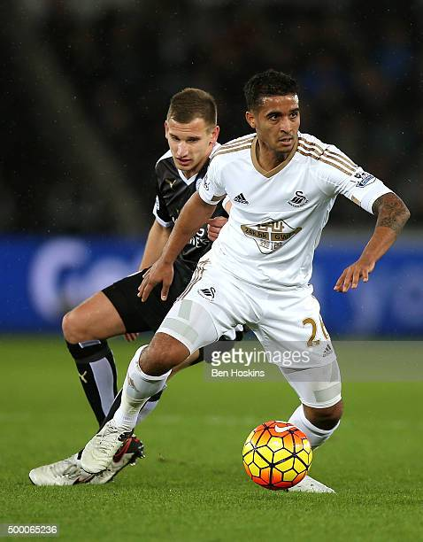 Kyle Naughton of Swansea City and Marc Albrighton of Leicester City compete for the ball during the Barclays Premier League match between Swansea...