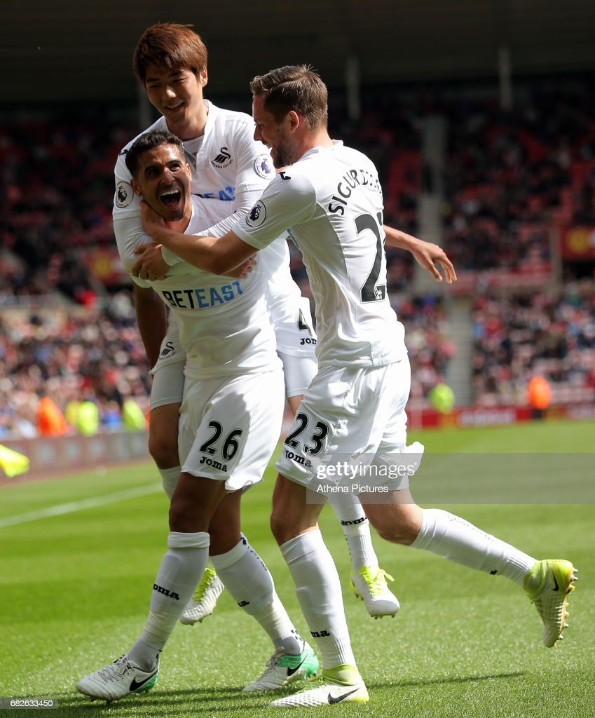 Kyle Naughton of Swansea City celebrates his goal with team mates Ki Sung-Yueng and Gylfi Sigurdsson during the Premier League match between Sunderland and Swansea City at the Stadium of Light on May 13, 2017 in Sunderland, England.