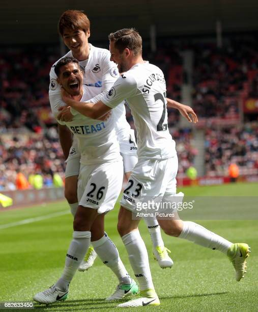 Kyle Naughton of Swansea City celebrates his goal with team mates Ki SungYueng and Gylfi Sigurdsson during the Premier League match between...