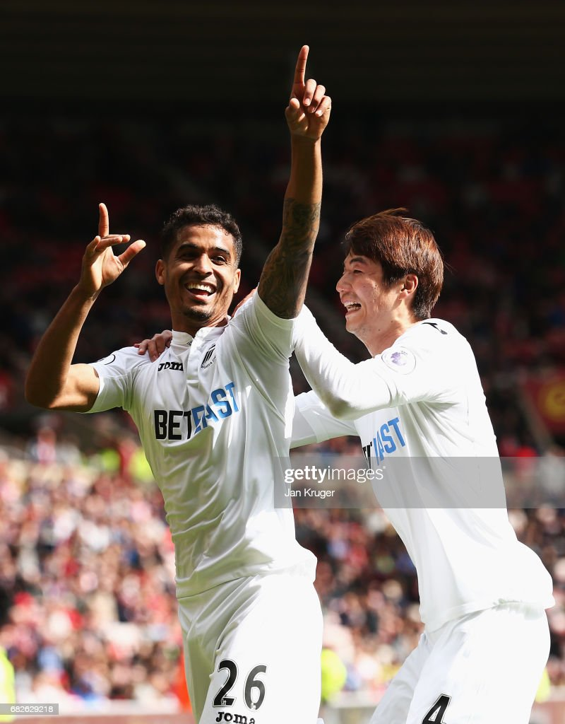 Kyle Naughton of Swansea City celebrates scoring his sides second goal with Ki Sung-Yueng of Swansea City during the Premier League match between Sunderland and Swansea City at Stadium of Light on May 13, 2017 in Sunderland, England.