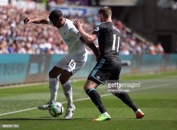 Kyle Naughton of Swansea City is challenged by Chris Brunt of West Bromwich Albion during the Premier League match between Swansea City and West...