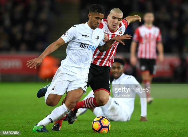 Kyle Naughton of Swansea City is challenged by Oriol Romeu of Southampton during the Premier League match between Swansea City and Southampton at...
