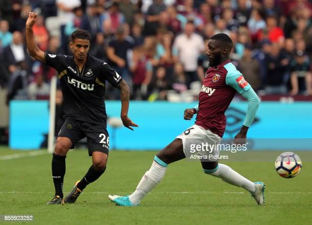 Kyle Naughton of Swansea City passes the ball past Arthur Masuaku of West Ham during the Premier League match between West Ham United v Swansea City...