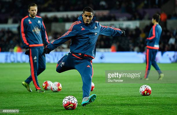 Kyle Naughton of Swansea City practices his shooting as he warms up prior to the Barclays Premier League match between Swansea City and Stoke City at...