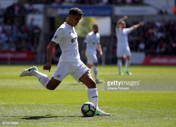 Kyle Naughton of Swansea City takes a shot during the Premier League match between Swansea City and Stoke City at The Liberty Stadium on April 22...