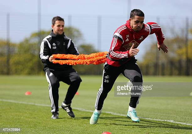 Kyle Naughton trains with team physiotherapist Richie Buchanan during the Swansea City training session at the Fairwood Training Centre on May 07...