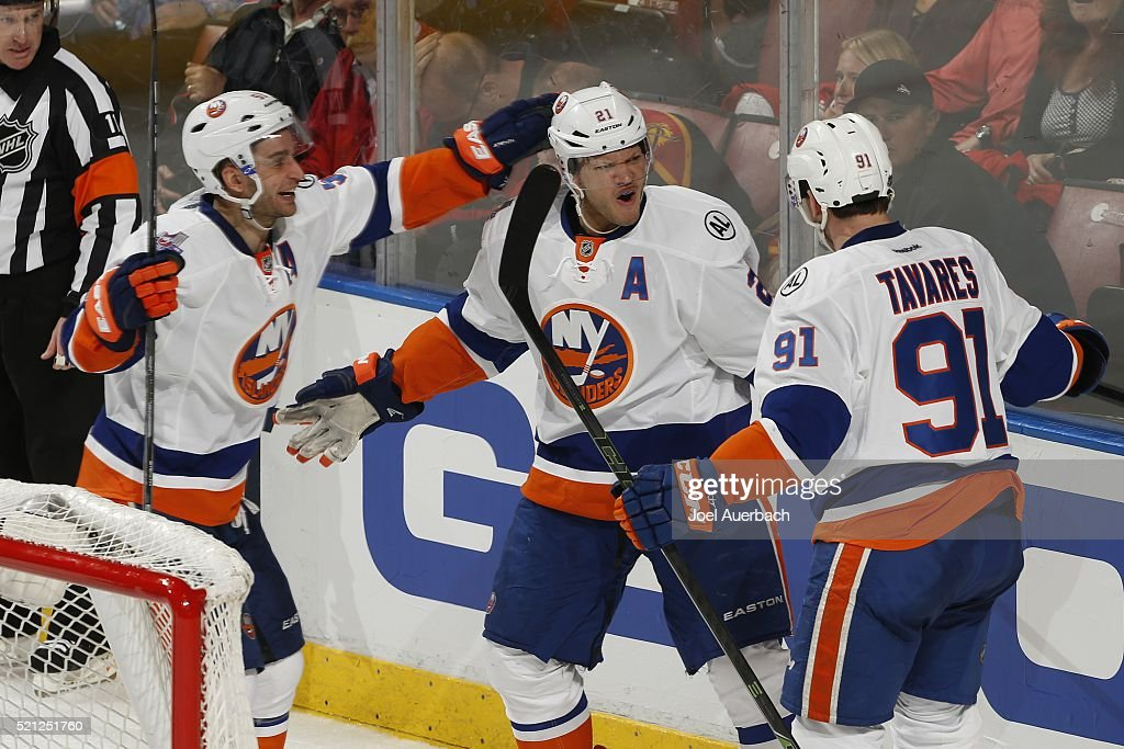 Kyle Okposo is congratulated by Frans Nielsen and John Tavares of the New York Islanders after scoring a third period goal against the Florida...