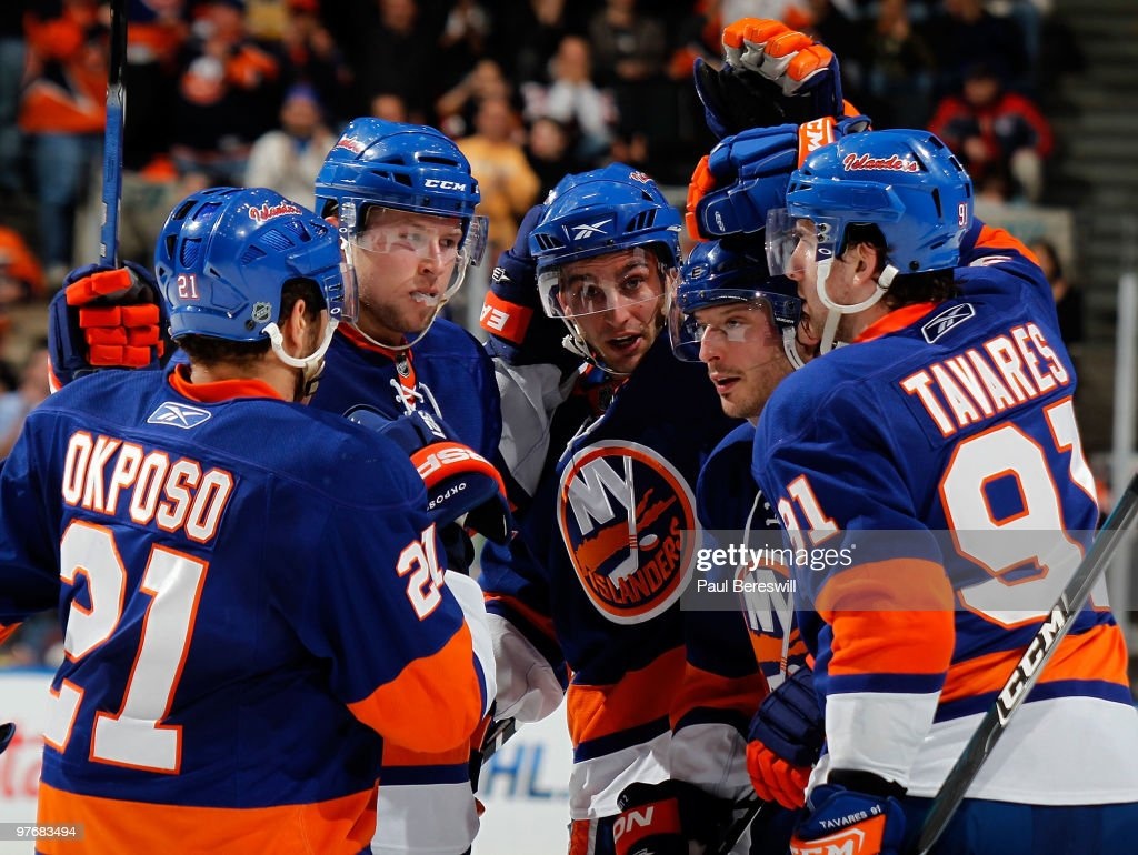 Kyle Okposo Josh Bailey and Frans Nielsen congratulate teammate Mark Streit along with John Tavares of the New York Islanders as they celebrate a...