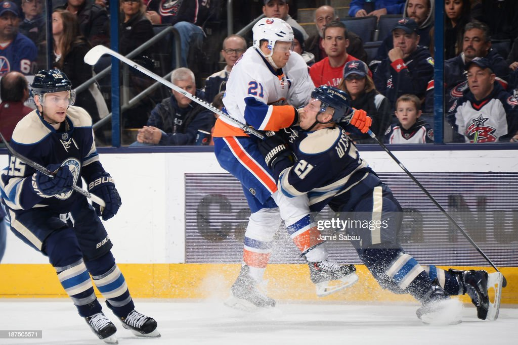 <a gi-track='captionPersonalityLinkClicked' href=/galleries/search?phrase=Kyle+Okposo&family=editorial&specificpeople=540469 ng-click='$event.stopPropagation()'>Kyle Okposo</a> #21 of the New York Islanders and <a gi-track='captionPersonalityLinkClicked' href=/galleries/search?phrase=James+Wisniewski&family=editorial&specificpeople=688111 ng-click='$event.stopPropagation()'>James Wisniewski</a> #21 of the Columbus Blue Jackets collide during the second period on November 9, 2013 at Nationwide Arena in Columbus, Ohio.