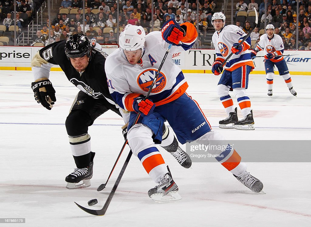 <a gi-track='captionPersonalityLinkClicked' href=/galleries/search?phrase=Kyle+Okposo&family=editorial&specificpeople=540469 ng-click='$event.stopPropagation()'>Kyle Okposo</a> #21 of the New York Islanders battles for the puck against <a gi-track='captionPersonalityLinkClicked' href=/galleries/search?phrase=Deryk+Engelland&family=editorial&specificpeople=3390067 ng-click='$event.stopPropagation()'>Deryk Engelland</a> #5 of the Pittsburgh Penguins in Game One of the Eastern Conference Quarterfinals during the 2013 NHL Stanley Cup Playoffs at Consol Energy Center on May 1, 2013 in Pittsburgh, Pennsylvania.