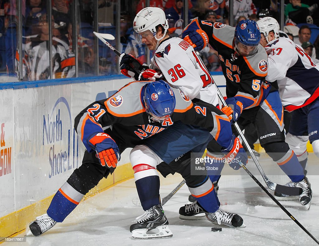 <a gi-track='captionPersonalityLinkClicked' href=/galleries/search?phrase=Kyle+Okposo&family=editorial&specificpeople=540469 ng-click='$event.stopPropagation()'>Kyle Okposo</a> #21 of the New York Islanders battles for the puck with Tomas Kundratek #36 of the Washington Capitals at Nassau Veterans Memorial Coliseum on March 9, 2013 in Uniondale, New York. The Islanders defeated the Capitals 5-2.