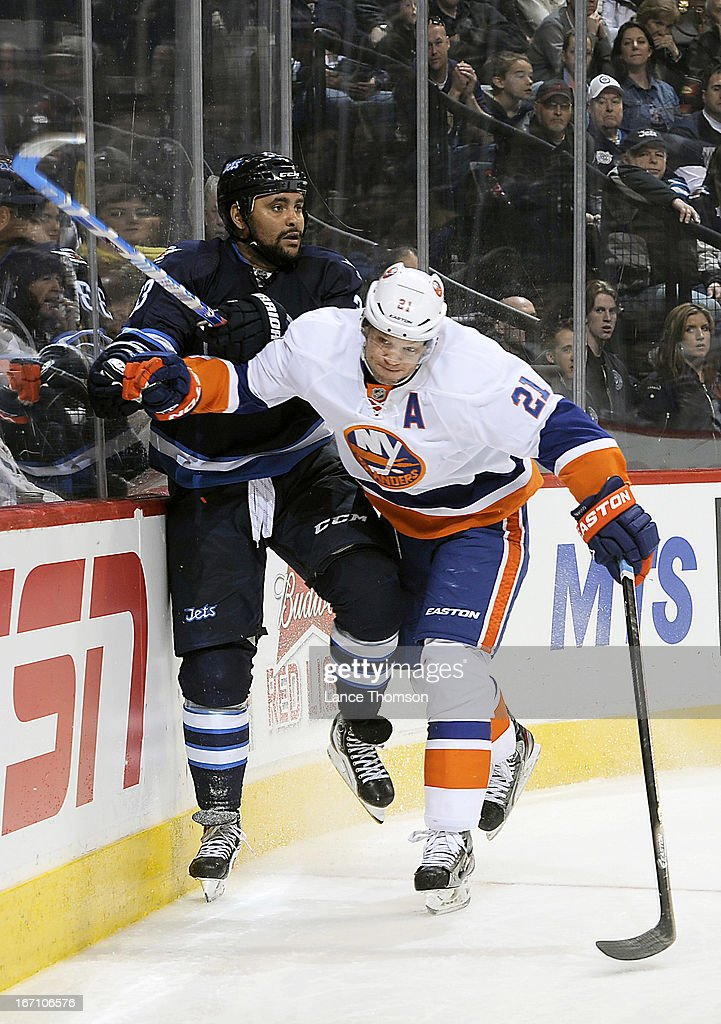 <a gi-track='captionPersonalityLinkClicked' href=/galleries/search?phrase=Kyle+Okposo&family=editorial&specificpeople=540469 ng-click='$event.stopPropagation()'>Kyle Okposo</a> #21 of the New York Islanders bounces off <a gi-track='captionPersonalityLinkClicked' href=/galleries/search?phrase=Dustin+Byfuglien&family=editorial&specificpeople=672505 ng-click='$event.stopPropagation()'>Dustin Byfuglien</a> #33 of the Winnipeg Jets as he checks him along the boards during third period action at the MTS Centre on April 20, 2013 in Winnipeg, Manitoba, Canada.